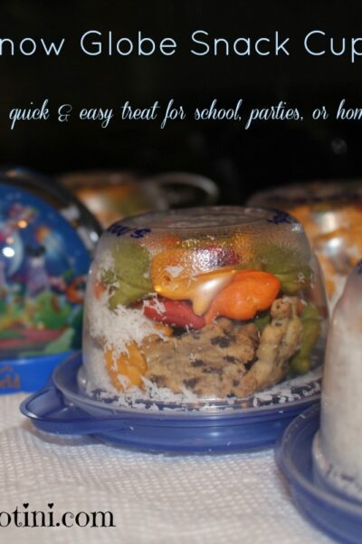 This super quick and easy snack cup idea is great for school events, birthday parties, or just stay at home snow days! Your kids will love both creating and eating their own magical snow globe snack cup treat.
