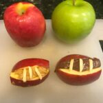These Vampire Apple bites are fiendishly good and easy to make. Made from apples and nut butter, they're a healthy, kid-friendly snack that's great for Halloween or any time of year. My kids loved making them! I also include a tip to turn them into footballs.