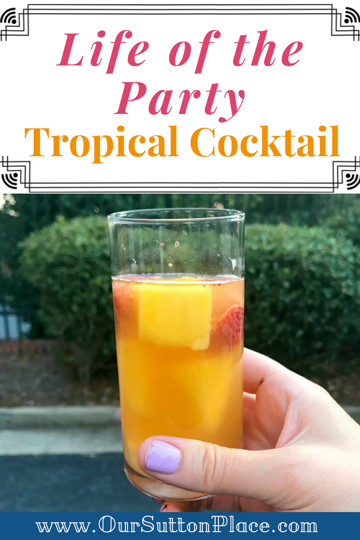 Looking for a light and refreshing holiday drink? This tropical prosecco rum cocktail recipe is super easy to make and perfect for any holiday gathering. Light, bubbly, and filled with fresh fruit and mint; it will wow all your friends and become The Life of the Party. #holidaycocktailrecipe #holidaycocktails #tropicaldrinks