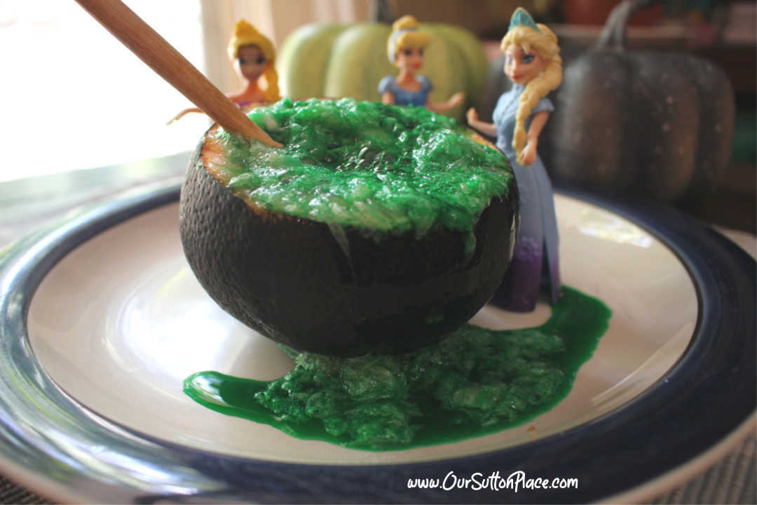 We're combining STEM, Disney inspired Zombies, and Halloween Witches to make an citrus (grapefruit) volcano that looks like an exploding Witches Brew Cauldron! This is a great Halloween party or even Disney Zombie party idea. #lemonvolcano #Disneyzombies #Halloween
