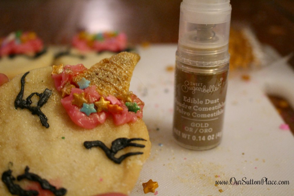 close up of unicorn cookie with gold dust