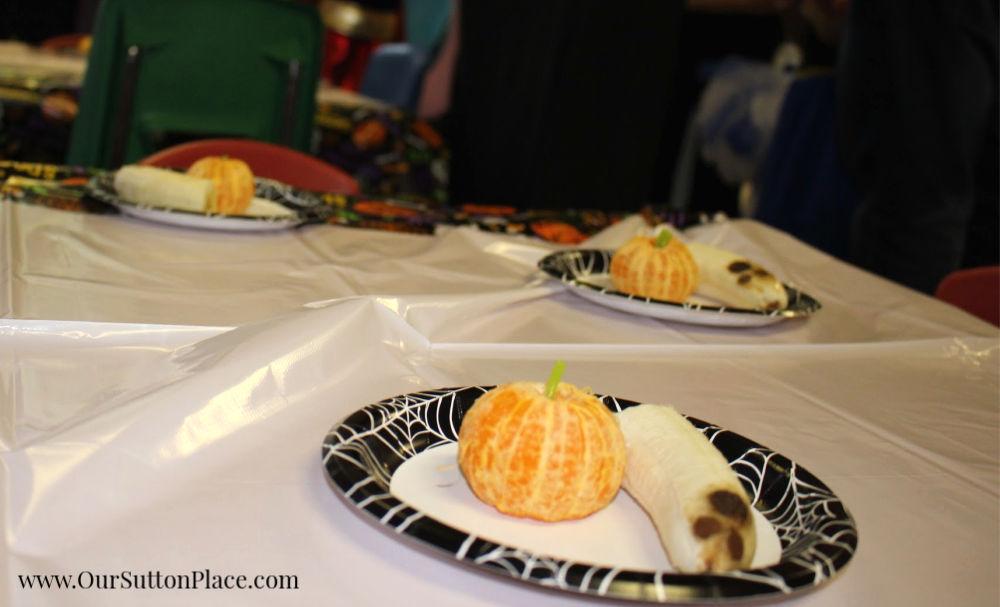 ghostly banana and pumpkin orange on table