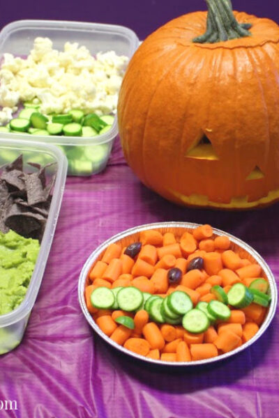 Frankenstein guacamole and carrot pumpkin Halloween food display
