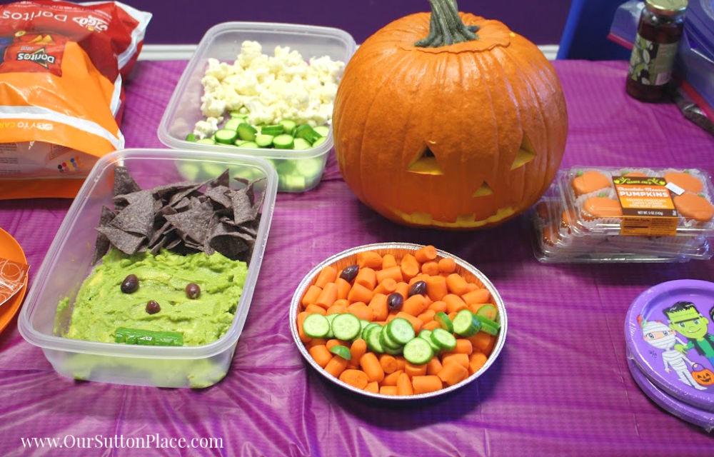 Frankenstein guacamole and carrot pumpkin Halloween food display