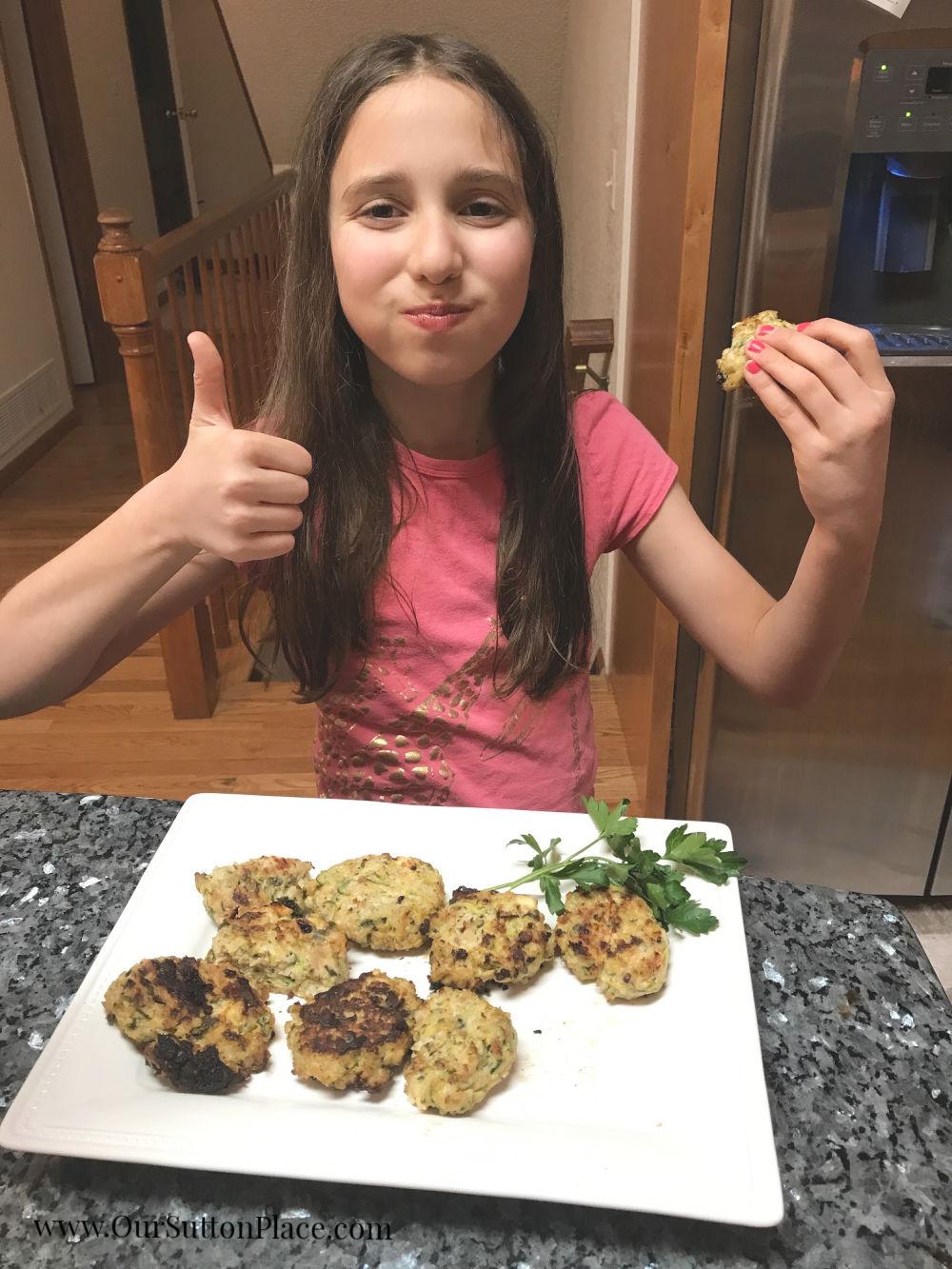 My kids enjoying the Zesty Zucchini Turkey Meatballs