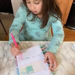 girl working on her Happy Planner