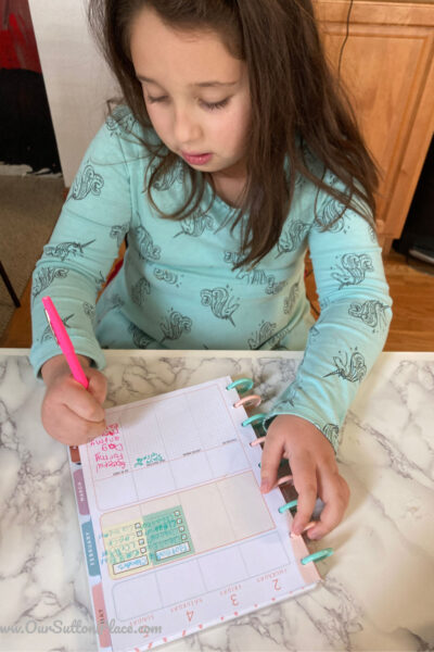 girl working on her Happy Planner
