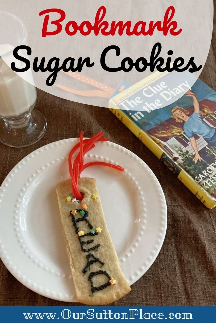 Bookmark shaped sugar cookie on a plate
