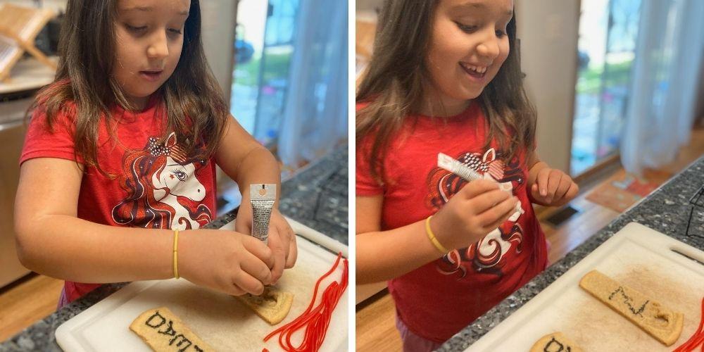girl decorating sugar cookies
