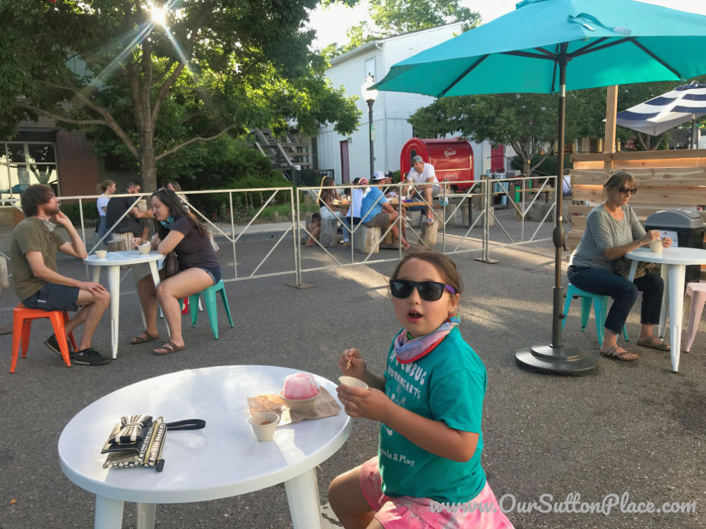 girl eating ice cream at outdoor dining where the streets are closed off