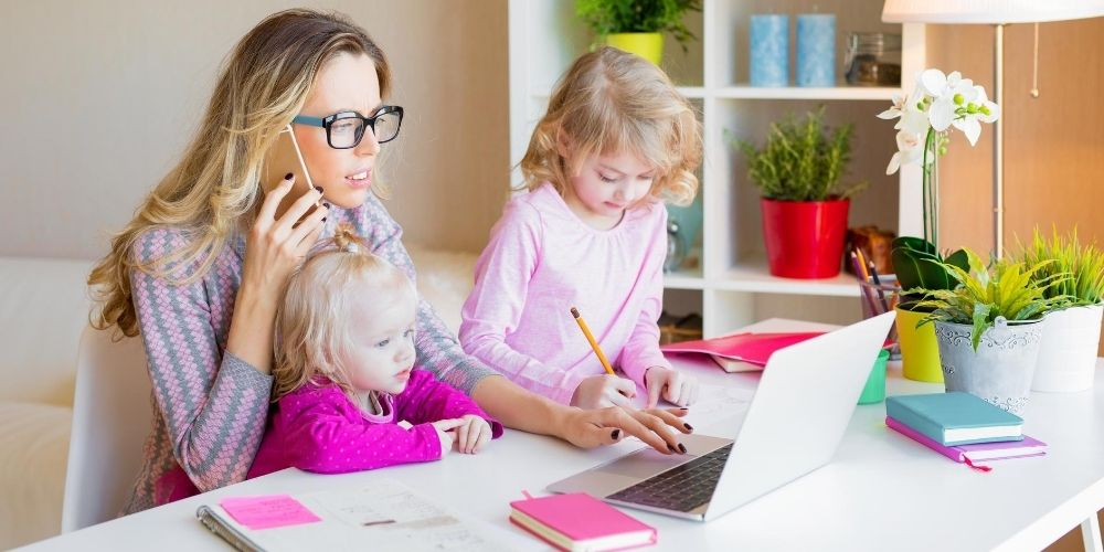 busy mom helping her kids on the computer