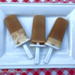 Flat lay view of 3 root beer float smoothie popsicles on a plate