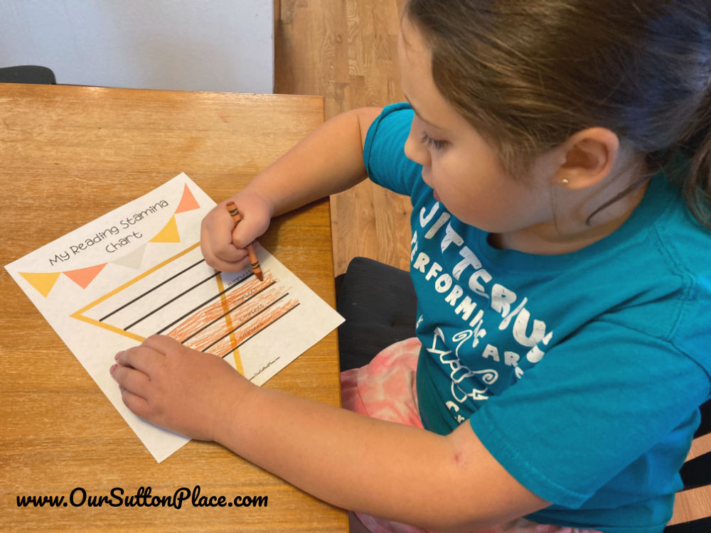 Girl filling in her Reading Stamina Chart