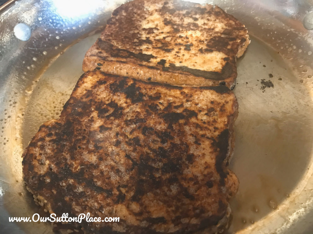 sliced French Toast cooking in the pan