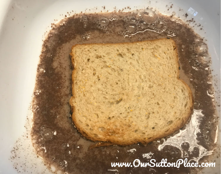 sliced bread soaking for 1 minute in French Toast mixture