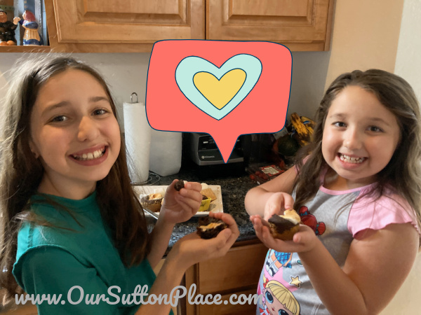 Two girls eating smores muffins