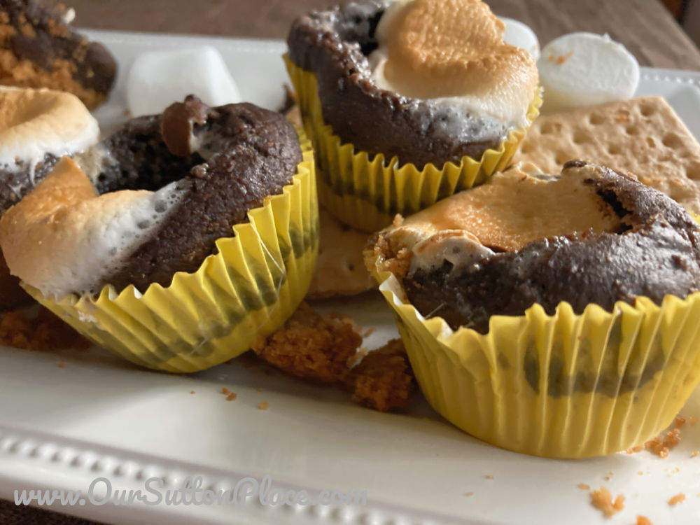 plate of s'mores muffins with yellow wrappers