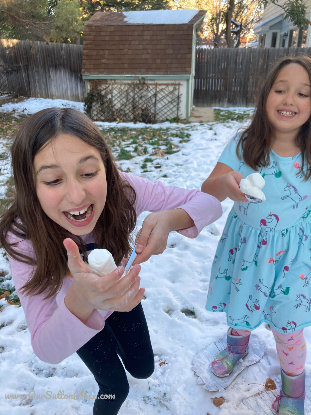 Two girls playing the Snowman Sasquatch Relay Race
