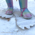 closeup of white cardboard sasquatch feet with person standing on them