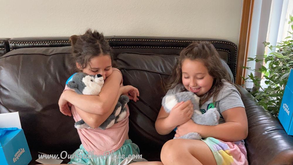 two girls hugging Send a Friend Stuffed Animals