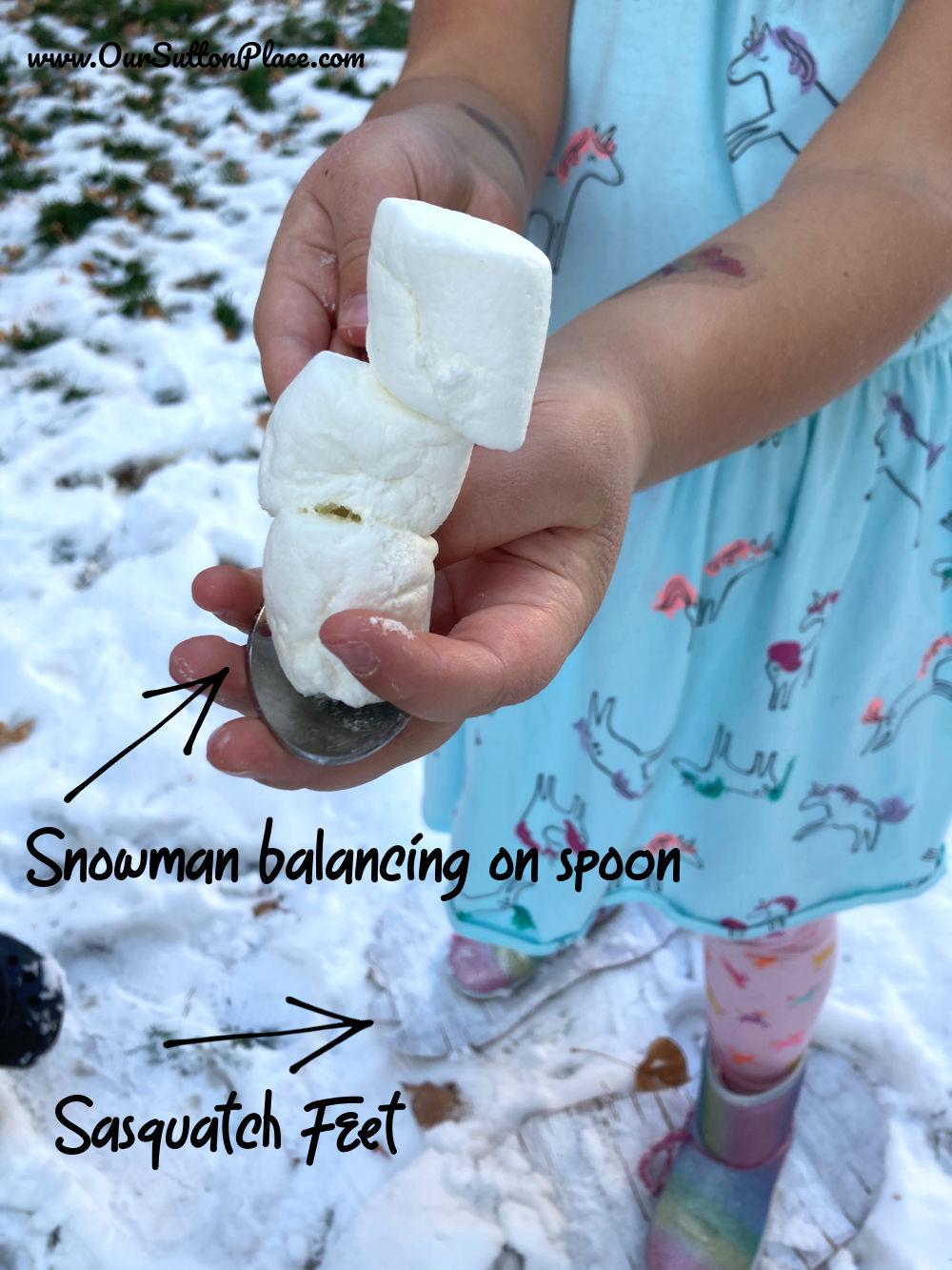 closup of supplies (snowman marshmallow and white cardboard Sasquatch feet
