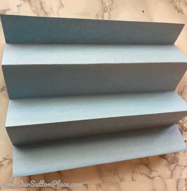 blue construction paper folded accordion style