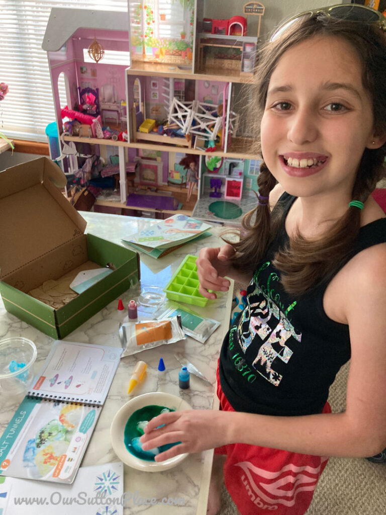 Girl using a KiwiCrate Stem project