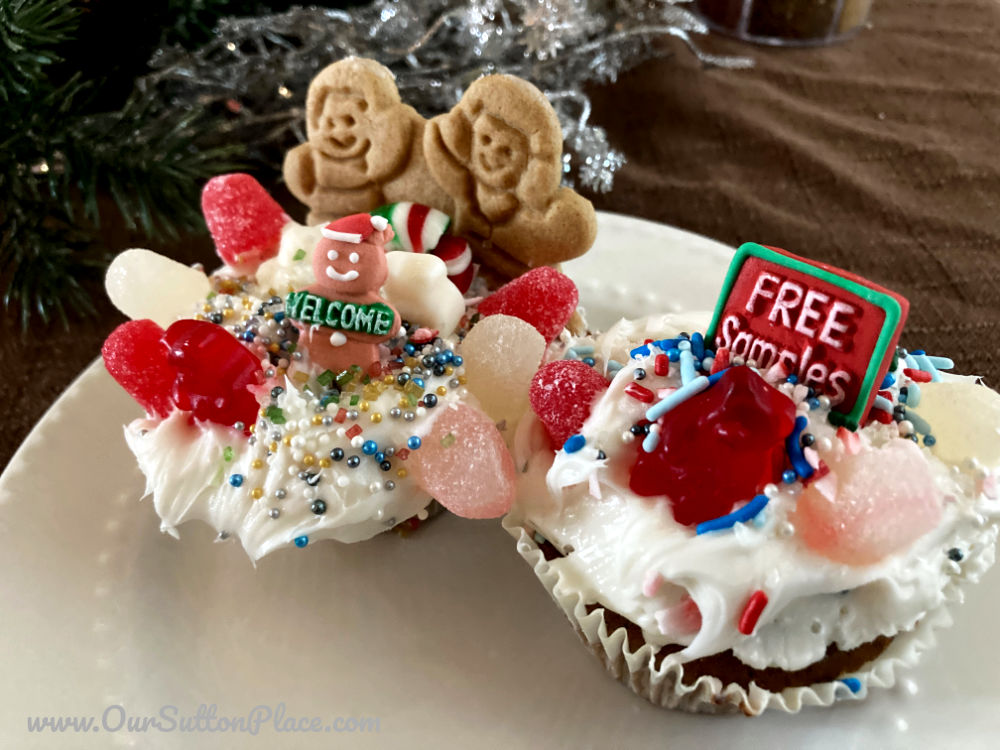 Picture of two Gingerbread House Cupcakes covered in toppings