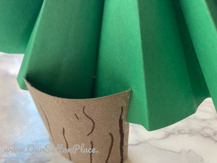 accordion paper tree in tree trunk
