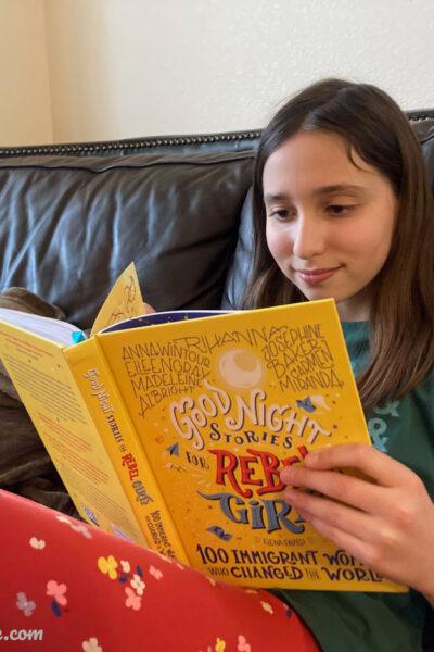 Girl reading a Rebel Girl book
