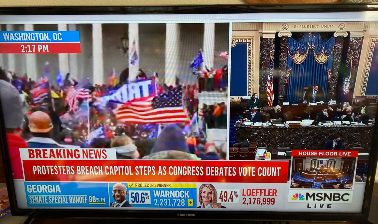 Picture of insurrections at the Capitol live on TV