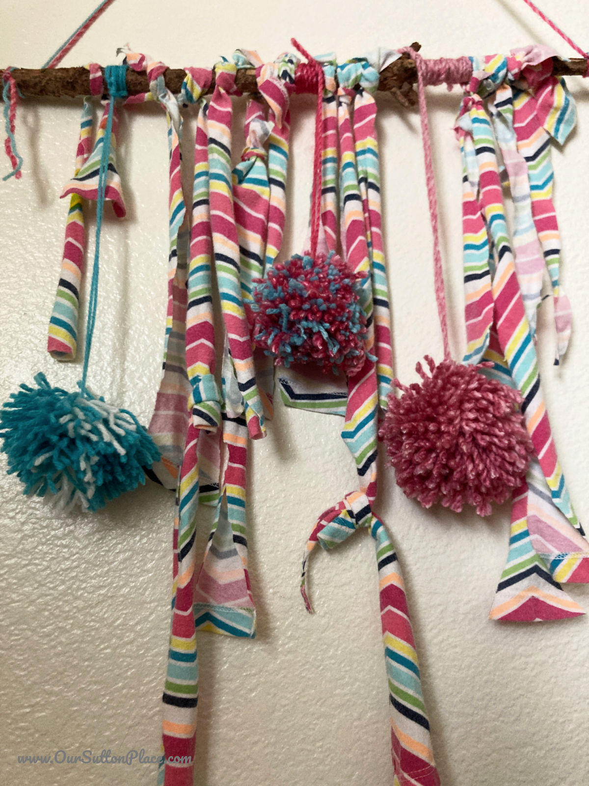 closeup of pom poms on a wall hanging
