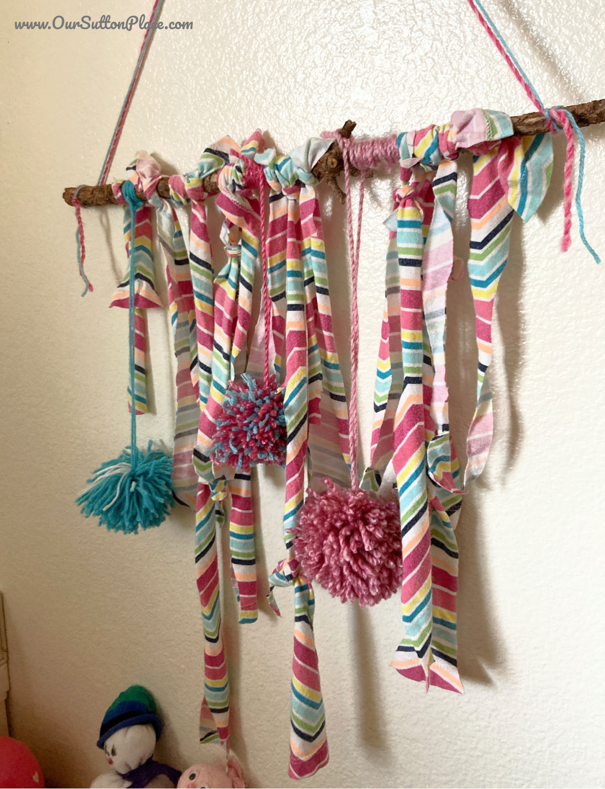 striped t-shirt fabric wall hanging with pom poms