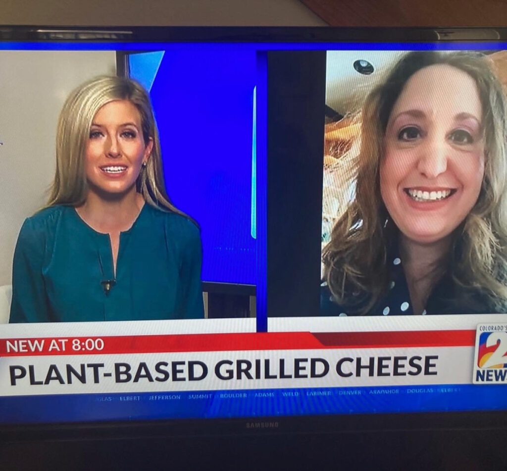 Picture of Shana on the news talking about plant-based grilled cheese