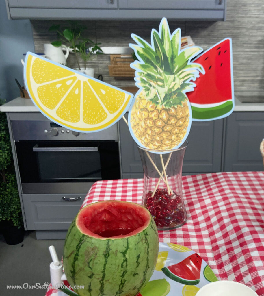summer themed Photo Booth Props in a glass vase with red marbles