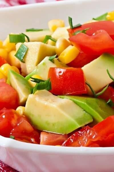 Tomato, Avocado, Corn Salad in a white bowl